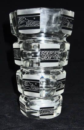 A rare vintage Czechoslovak Art Deco glass vase by the Palda factory. The vase is a heavy blown glass vase that has been cut to form an eight sided form.