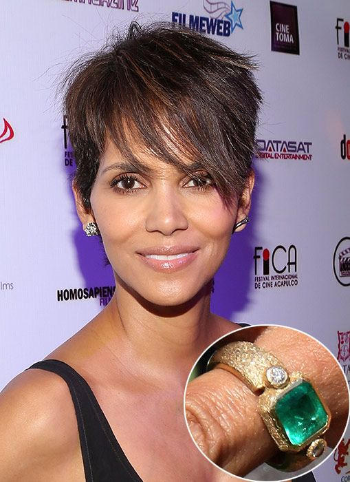 Halle Berry ... Olivier Martinez commissioned a unique piece of jewellery from his Paris neighbour, jeweller Robert Mazlo, to present to his actress love Halle Berry. The ring features a central emerald flanked by two diamonds, set in a textured gold band.