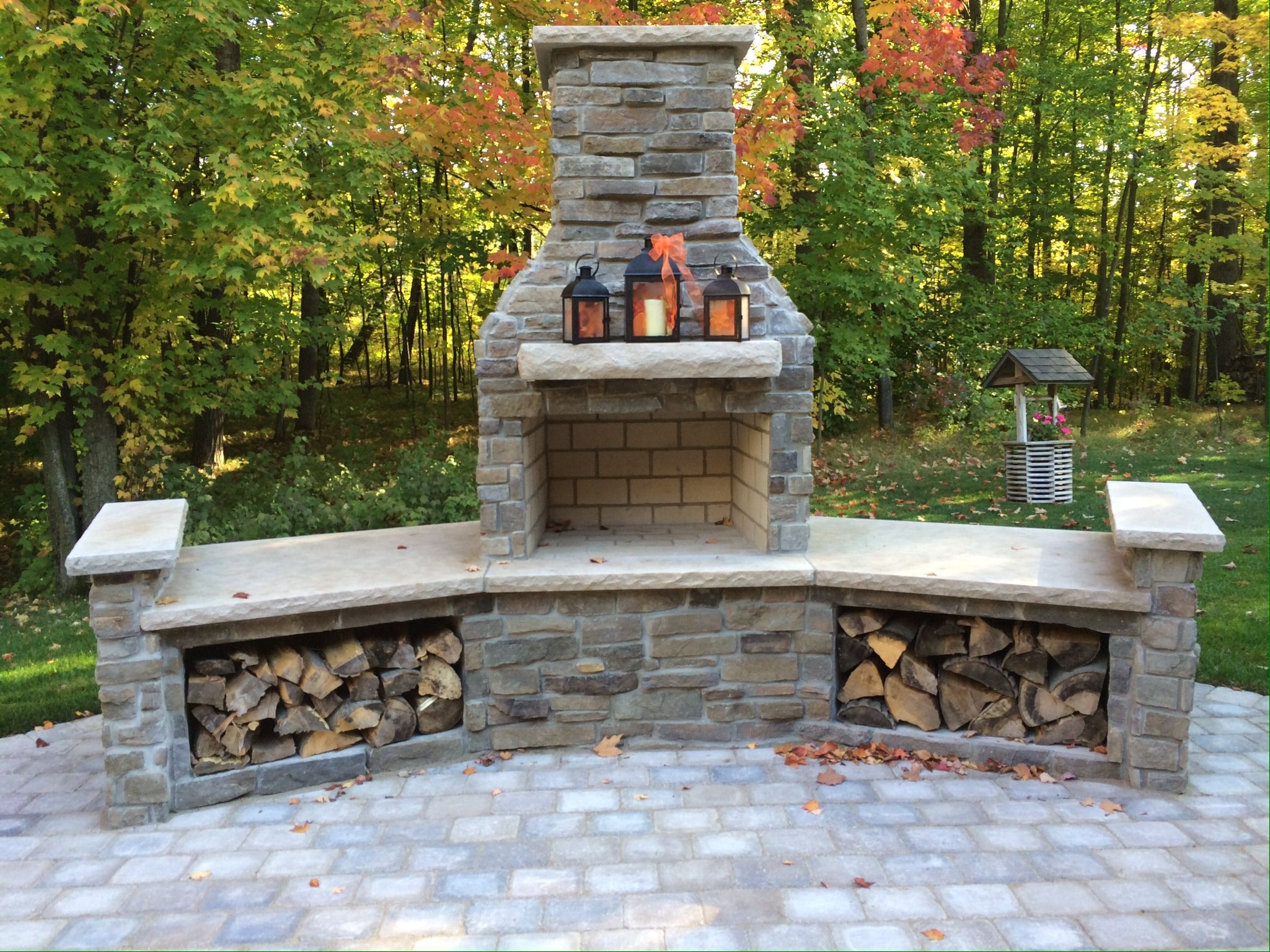 outdoor fireplace limestone mantle wood boxes fire places