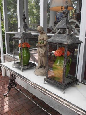 Mary Carol Garrity `Statuary scattered throughout the garden, filled with pumpkins, moss, and pinecones.