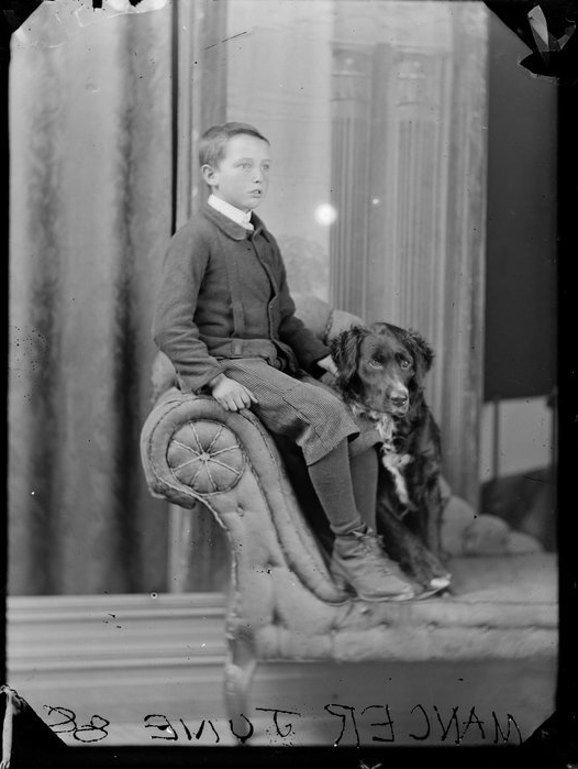 Formal portrait of boy and his dog. Photo says Mancer June '88. (1888)