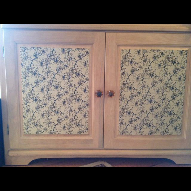 Wallpaper cabinet front. I used wrapping paper and modge ...