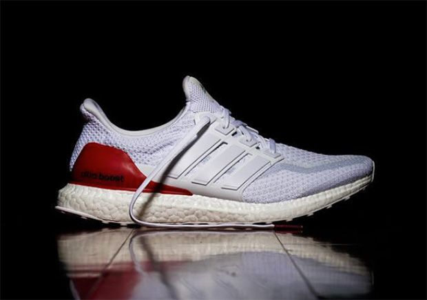 pretty nice 8741a 9947b A new adidas Ultra Boost is coming to retailers featuring a near Triple  White colorway with a splash of red on the heel for a simple, refined look.