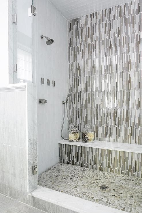 Fantastic Walk In Shower Boasts An Accent Wall Clad In Taupe And Gray Vertical Glass T Spa Master Bathroom Bathroom Wall Tile Design Bathroom Remodel Small Diy