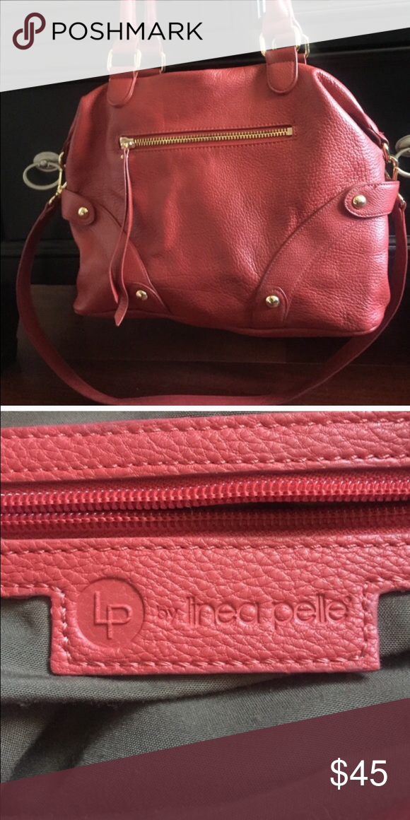 Red Linea Pelle Handbag Linea Pelle Red Handbag. Has longer strap for shoulder use. Used but still in great condition. Very comfortable and great for both every day use or special occasions. Linea Pelle Bags Shoulder Bags
