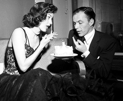 Frank Sinatra & Ava Gardner share a cake for Frank's birthday backstage