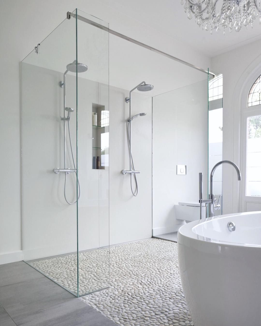 Modern bathroom features a crystal chandelier free standing acrylic ...