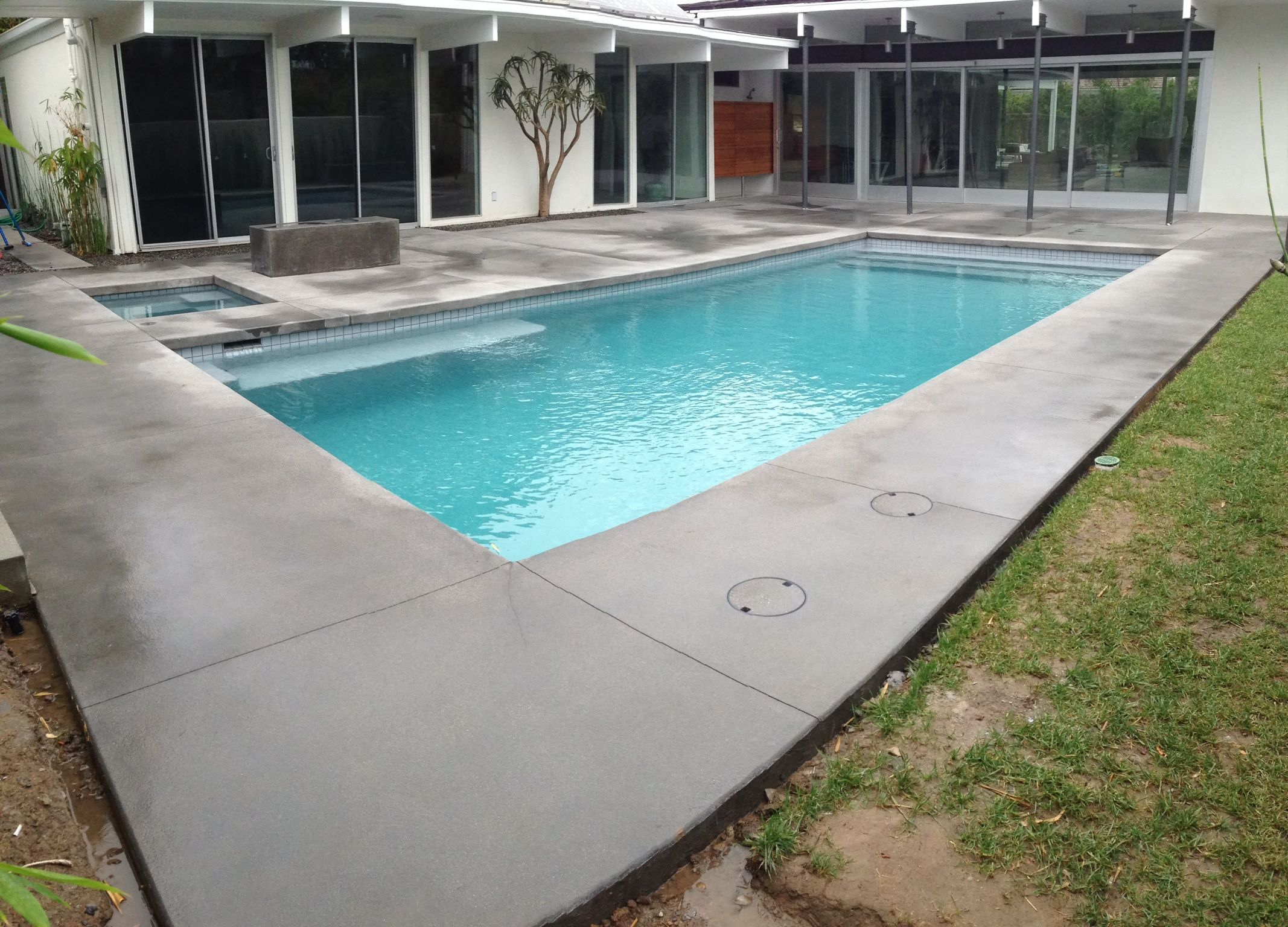 Colored pool deck sand blast finish concrete decks for Concrete swimming pool
