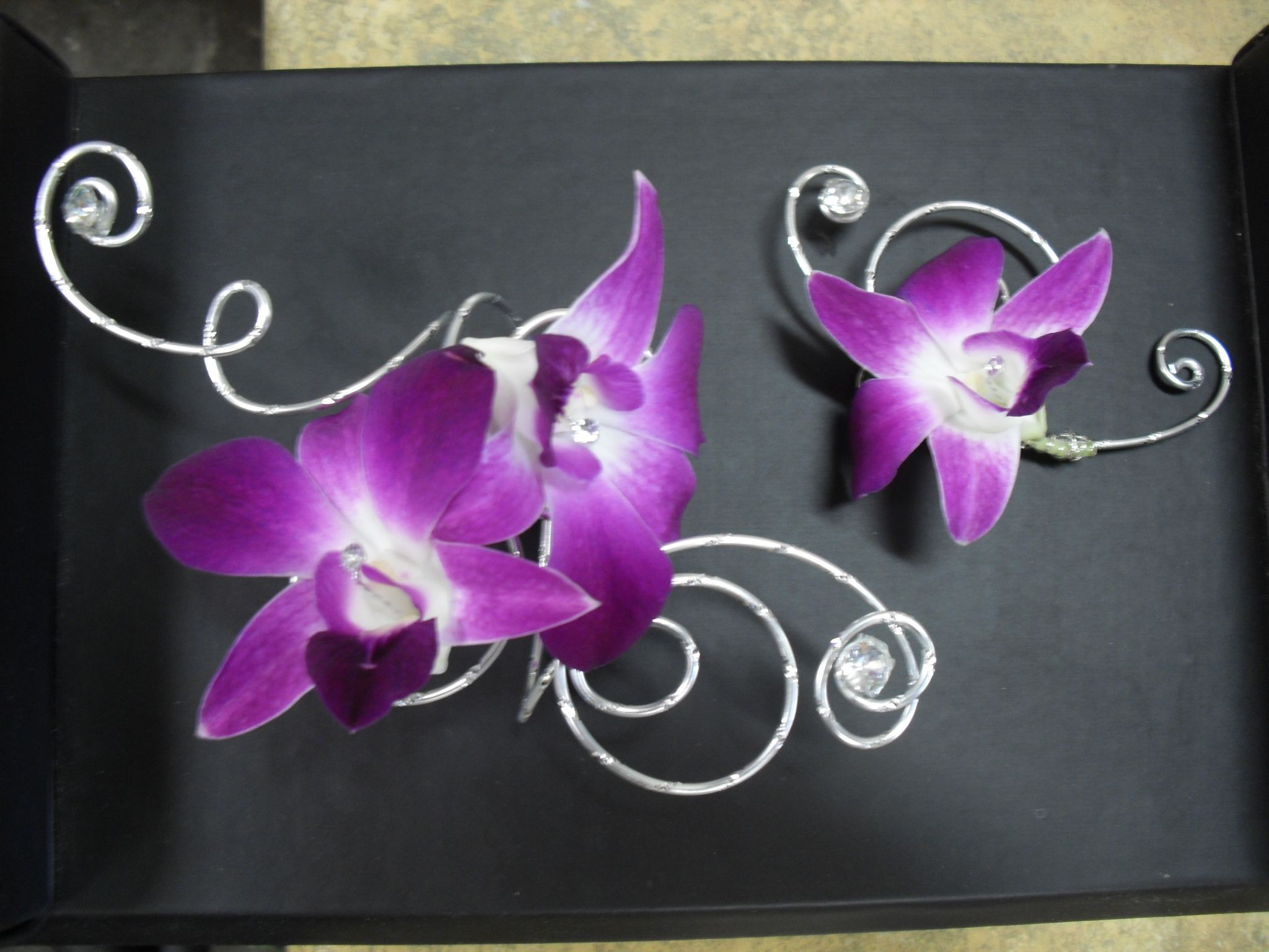 Purple and silver corsage and boutonniere for wedding and prom.