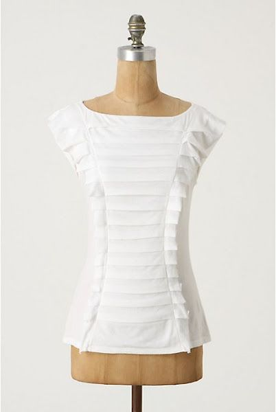 This interpretation of the white shirt would look beautiful with a navy pantsuit.