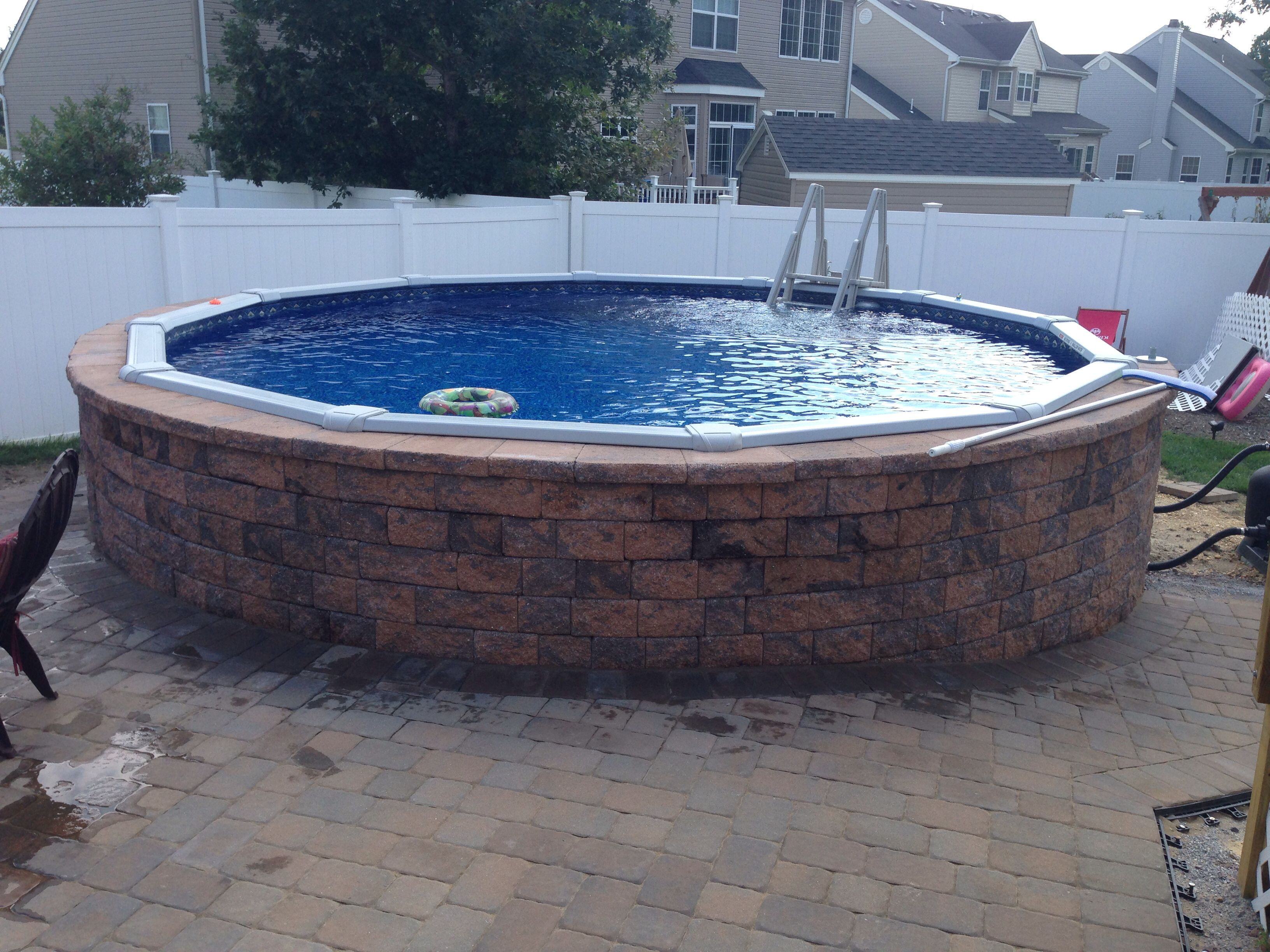 Ephenry wall stone around above ground swimming pool for Decor around swimming pool