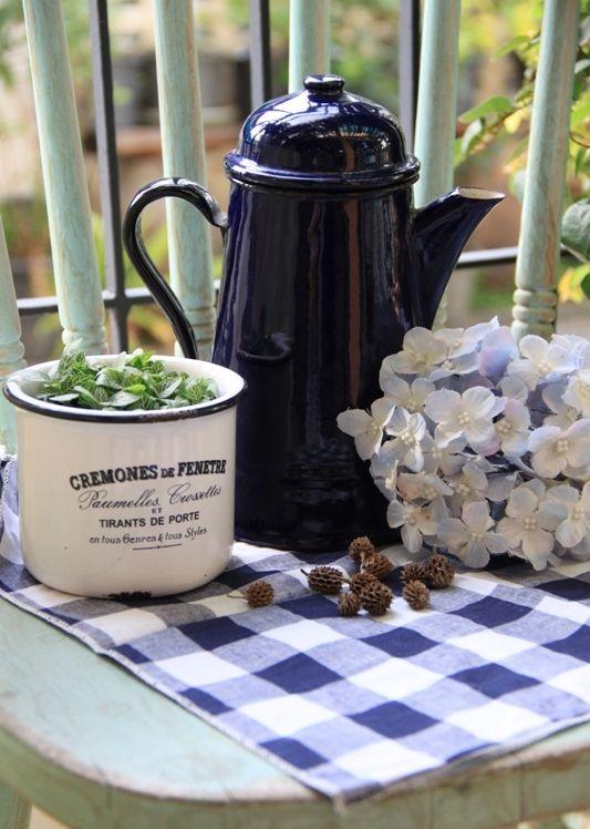 vintage enamel tea pot in dark blue