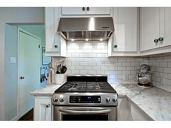 kitchen decorative tiles complimenting the marble and stainless kitchenaid 1074