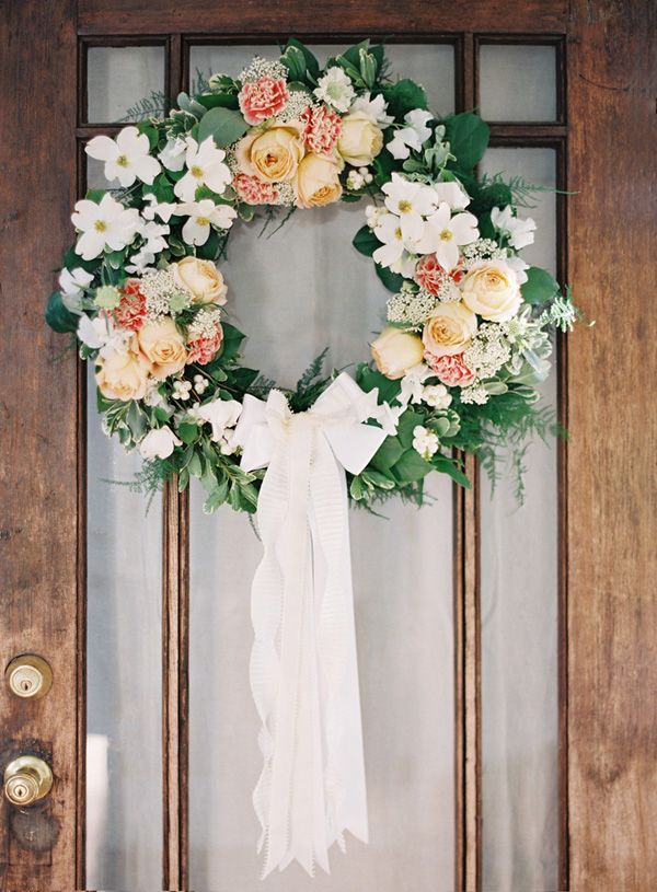 Add extra romance to a spring floral wreath by tying on a cascading white ribbon. & 35 Spring Wreaths That Will Freshen Up Your Front Door | Wedding ...