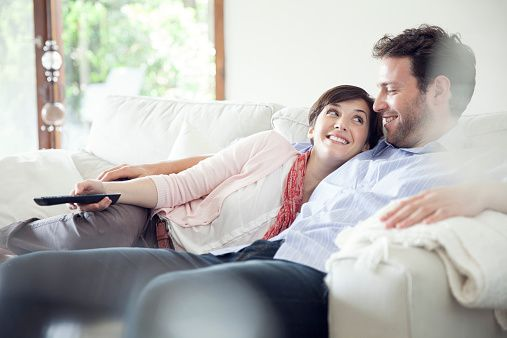 Couple Watching Tv Together On Sofa Strong Marriage Couples