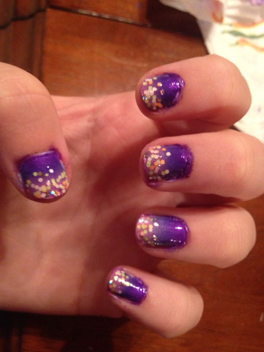 A little messy but a faded purple deisgn with some glitter. Reminds ...