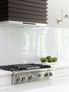 Modern White Kitchen With Stacked 2 X 10 White Glossy Subway Tile
