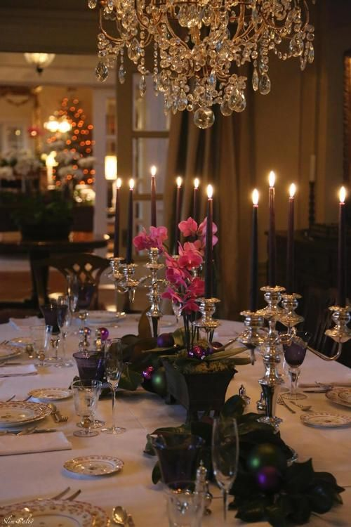 dining room setting, chandelier, dark walls, candlelight