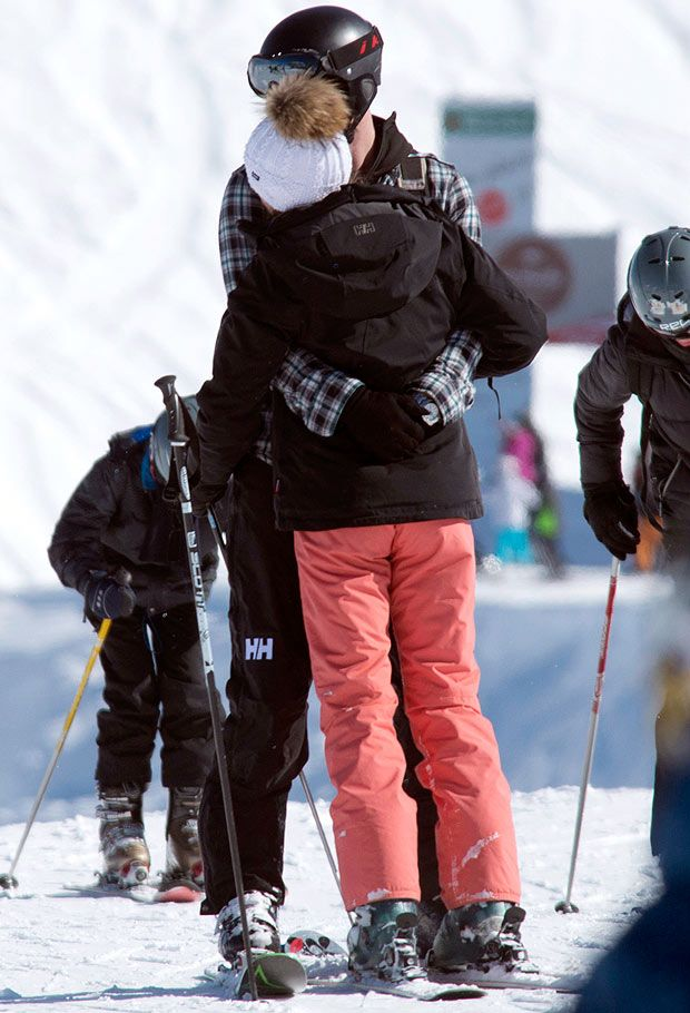 Hugging ... Harry and Cressida share a cuddle on Swiss ski slope yesterday