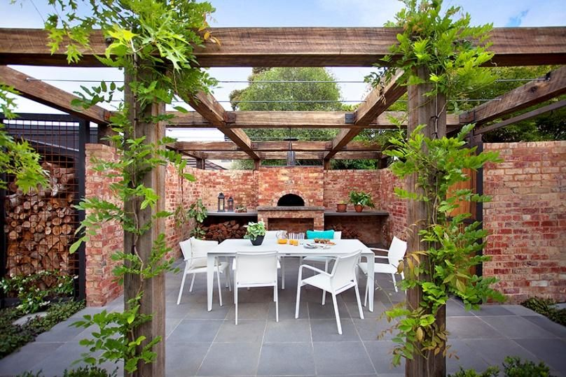 Vine covered pergola entertaining area with pizza oven Design Ian