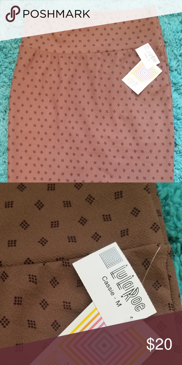 59206528da Lularoe Cassie Pencil Skirt Chocolate brown pencil skirt with darker brown/black  diamond shaped designs. Very cute. This Cassie is a lighter material.