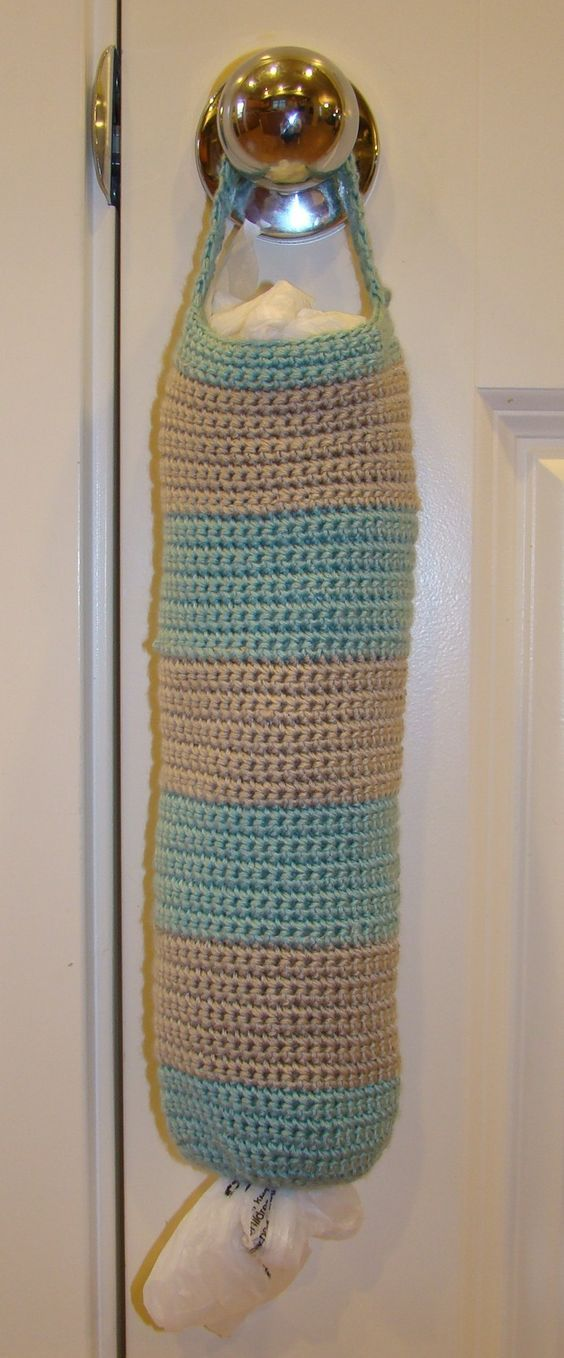 Easy, Cute, and Useful! This Grocery bag holder can as long as you need. It is made from Spa Yarn (size 3) but will work with any yarn or colors you want. Great idea for those who hold on to their grocery bags.. #diyyarnholder