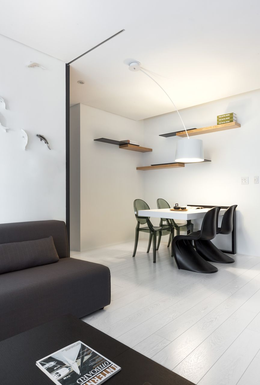 Taichung hsu residence is a minimalist house located in taichung taiwan designed by z axis design the mostly white interior is outfitted with various