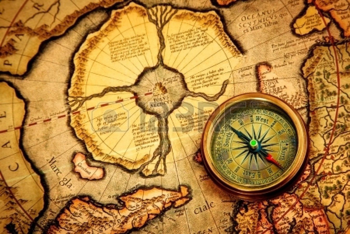 Vintage compass lies on an ancient map of the North Pole ...