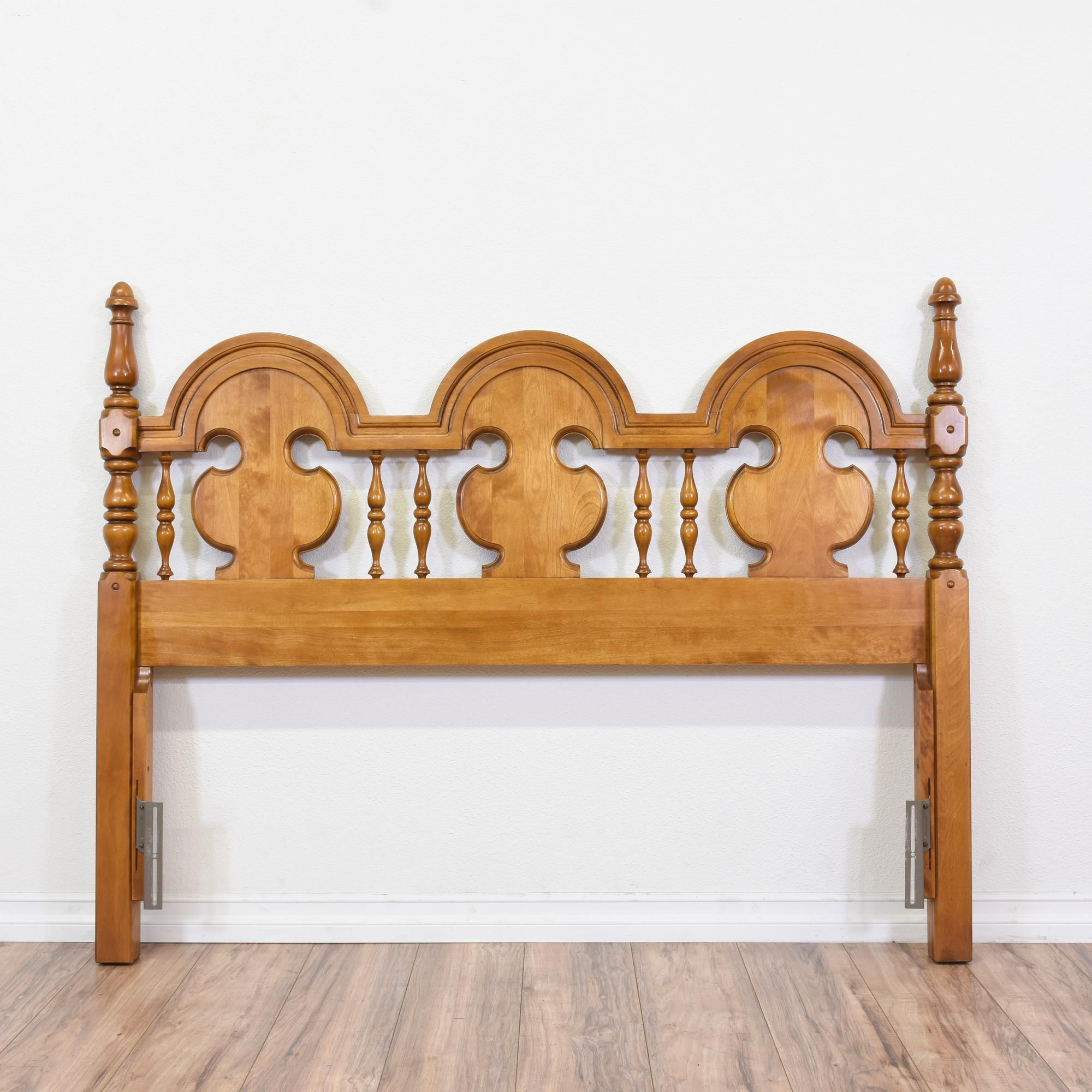 This country chic headboard is featured in a solid wood
