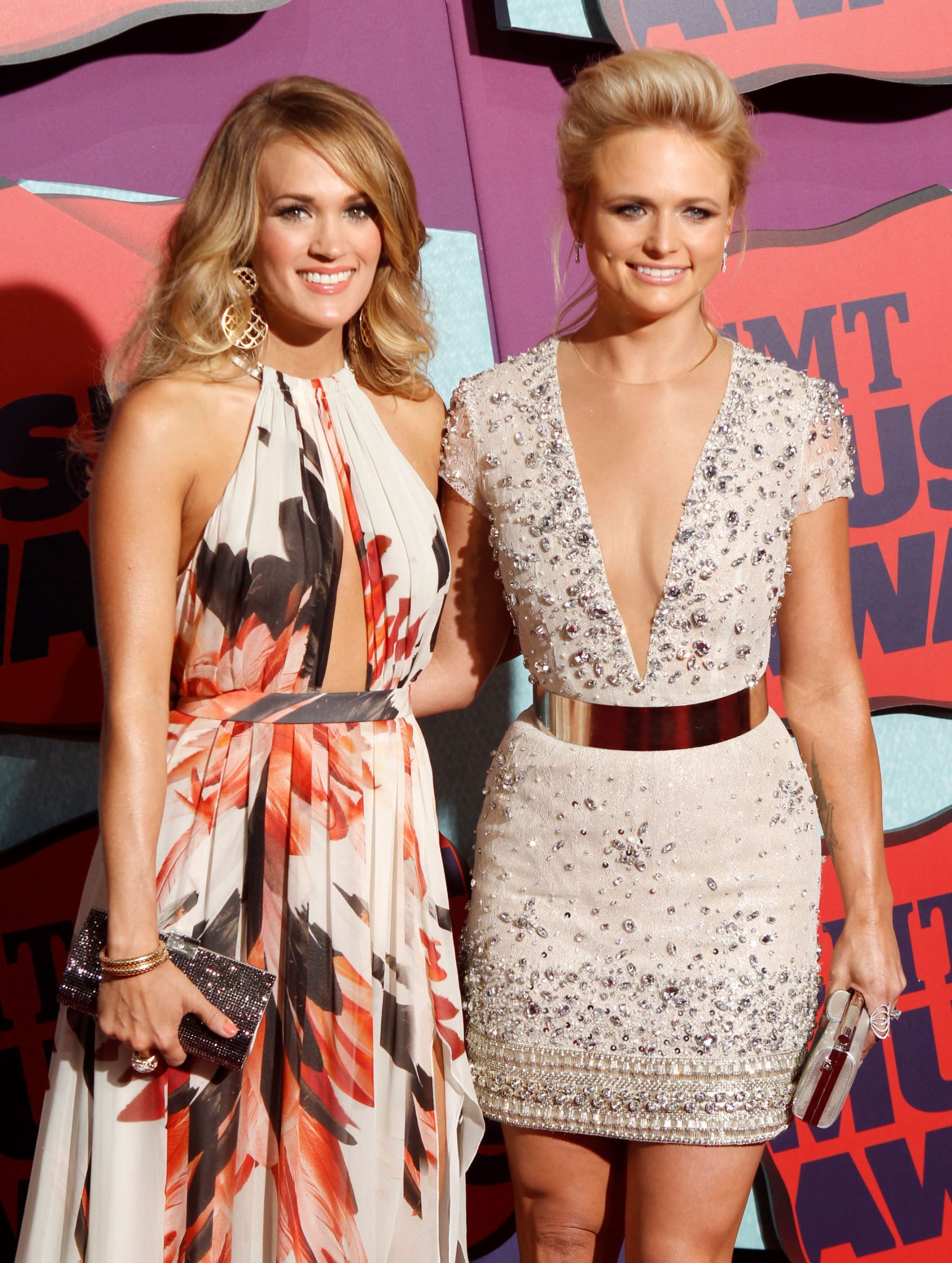 FILE - In this June 4, 2014 file photo, Carrie Underwood, left, and Miranda Lambert arrive at the CM... - The Associated Press