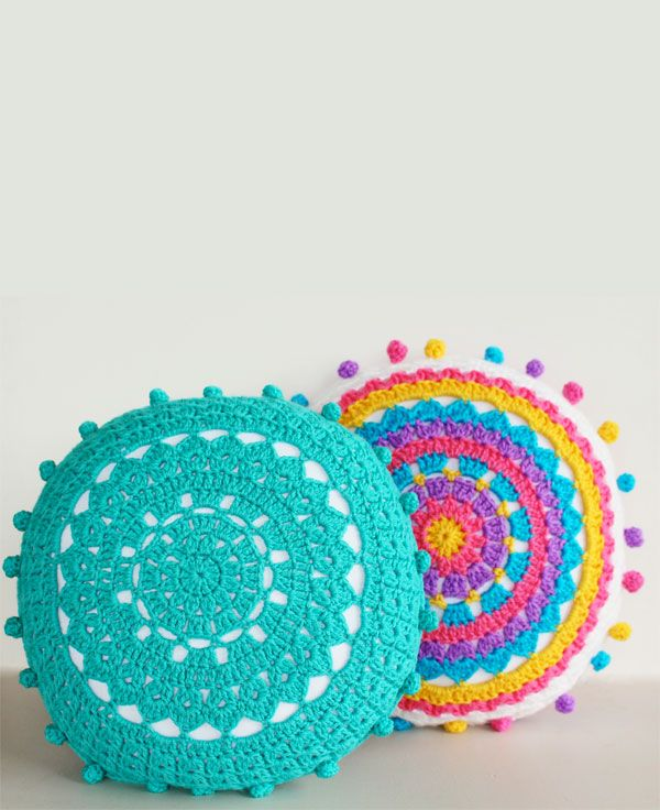 Adorable cushion with pompoms