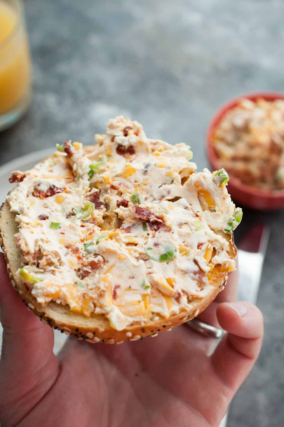 A delicious bacon cream cheese spread that you can't find in stores. Loaded with all the favorites like cheddar, bacon, scallion, and sun-dried tomato. Make your next bagel even better!   macheesmo.com #breakfast #bagel #creamcheese #bacon #cheddar