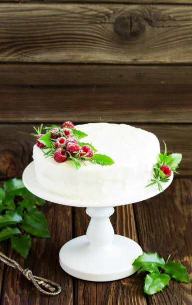 new year or christmas cake with raspberries selective focus