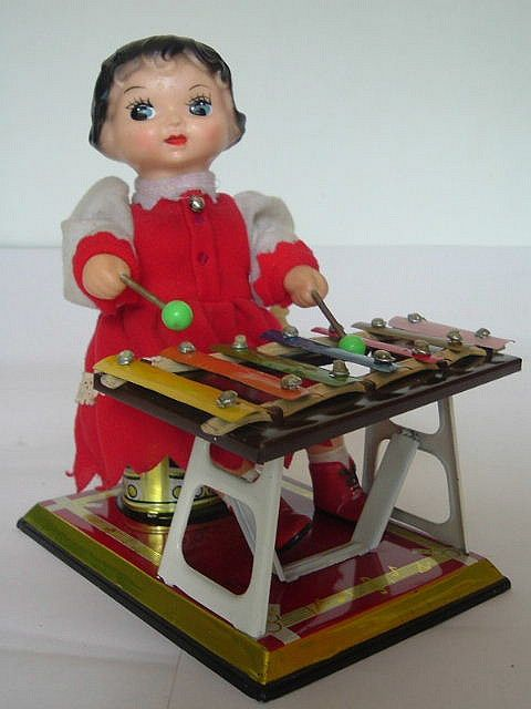 Chinese doll. playing marimba, 50's