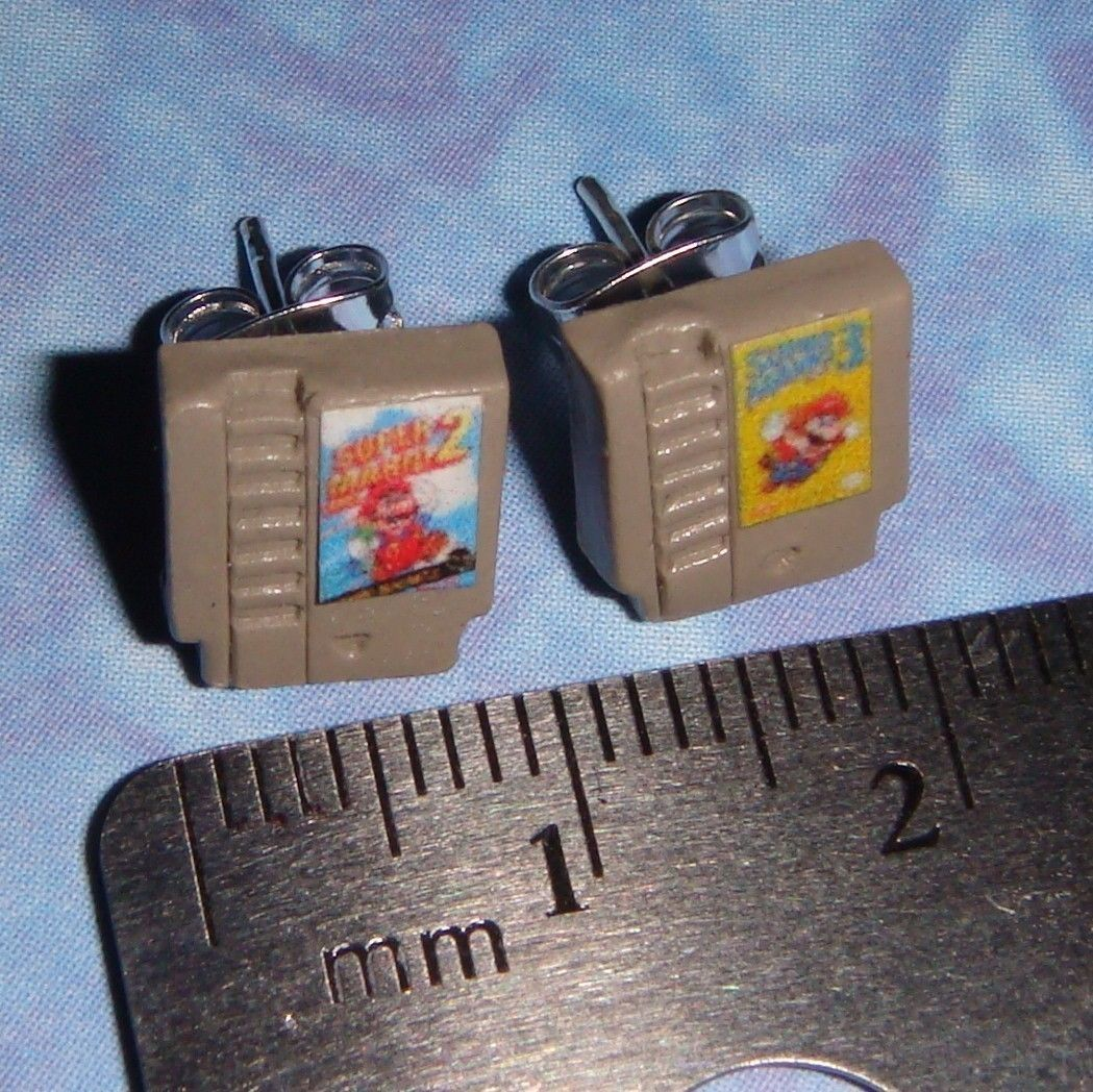STUD EARRINGS Nintendo games cartridge.