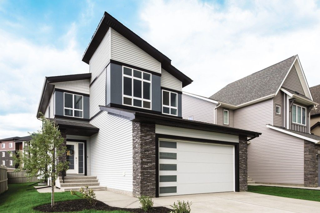 This House Looks Like It S From The Future I Love The Garage Door The Most With The Side Windows We Re Looking At Getting Garage Doors Garage Overhead Door