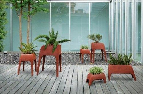 The cute decorative items are called Safari Planters and were - designer gartenmobel kenneth cobonpue