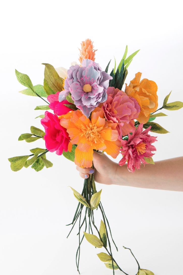 Spring Has Sprung And There S No Better Way To Celebrate Than With A Floral Diy In This Bri Paper Flowers Paper Flower Backdrop How To Make Paper Flowers