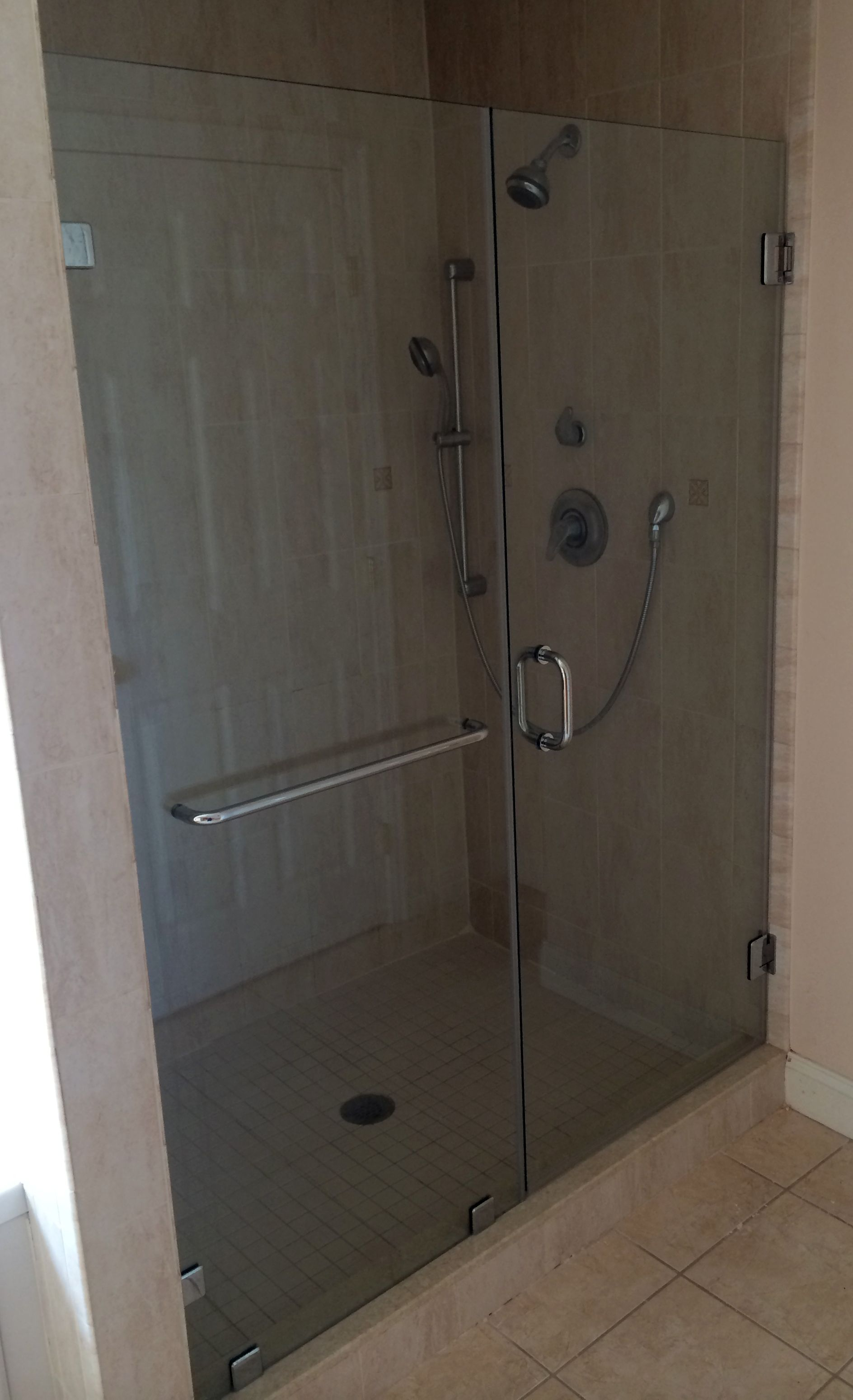 Frameless Shower Door And Panel Installed With Clips And A 20 Towel Bar In The Stationary Panel Polis Glass Shower Doors Sterling Shower Doors Glass Shower