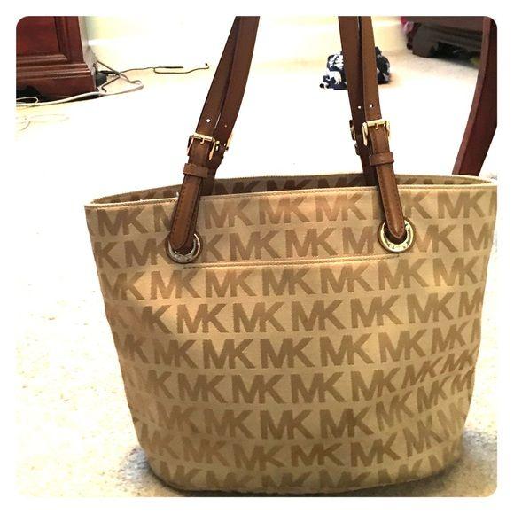 4e0e46c3dcf073 Tan Michael Kors hand bag Tan and light brown MK bag, some stains on inside  of bag, good condition Michael Kors Bags Shoulder Bags