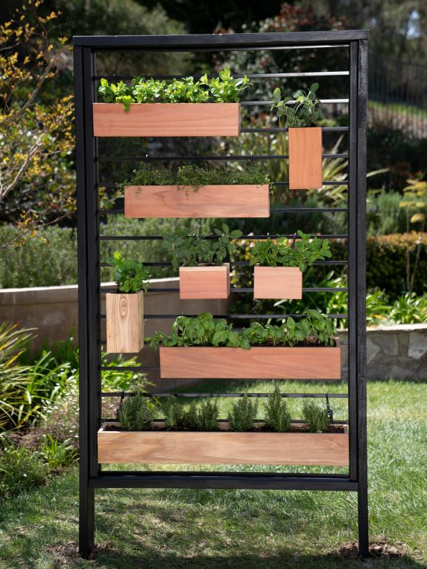How to Make a Vertical Herb Garden From a Fence is part of Vertical garden design, Vertical herb garden, Vertical garden, Vertical garden diy, Vertical herb gardens, Diy garden - If your garden is short on space, DIY Network shows you how to plant vertically with a garden wall made from a section of metal fence, basic lumber and redwood planter boxes