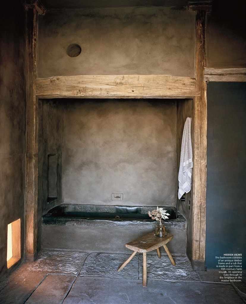 Penthouse Master Bath - The framework for the soaking tub and the double basin sink was crafted from a 17th Century stone water trough weathered and smoothed by time.