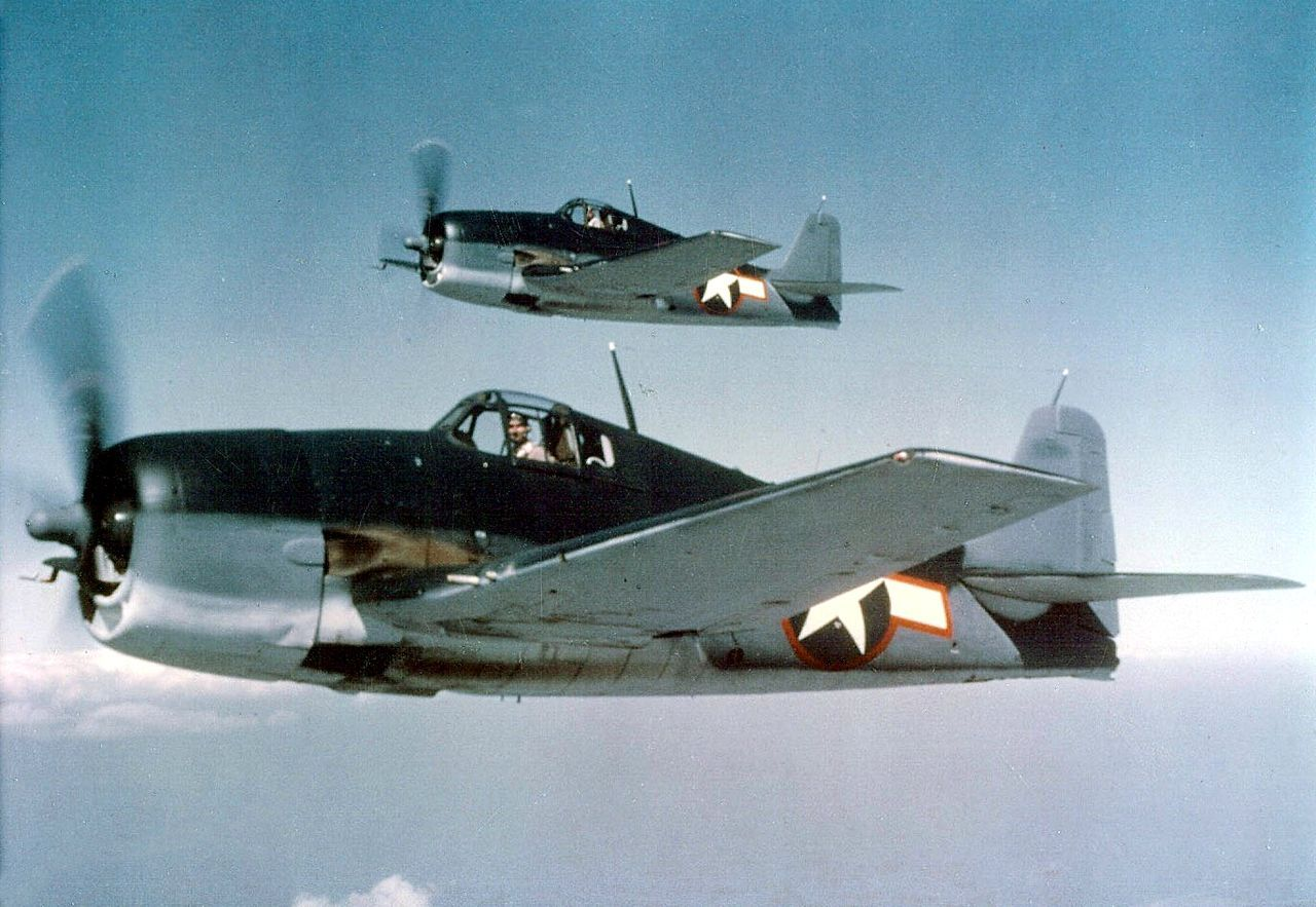 Two U.S. Navy Grumman F6F-3 Hellcats in tricolor camouflage, sea blue, intermediate blue and insignia white. (  U.S. Navy National Museum of Naval Aviation photo No. 2011.003.274.018 via Wikipedia)