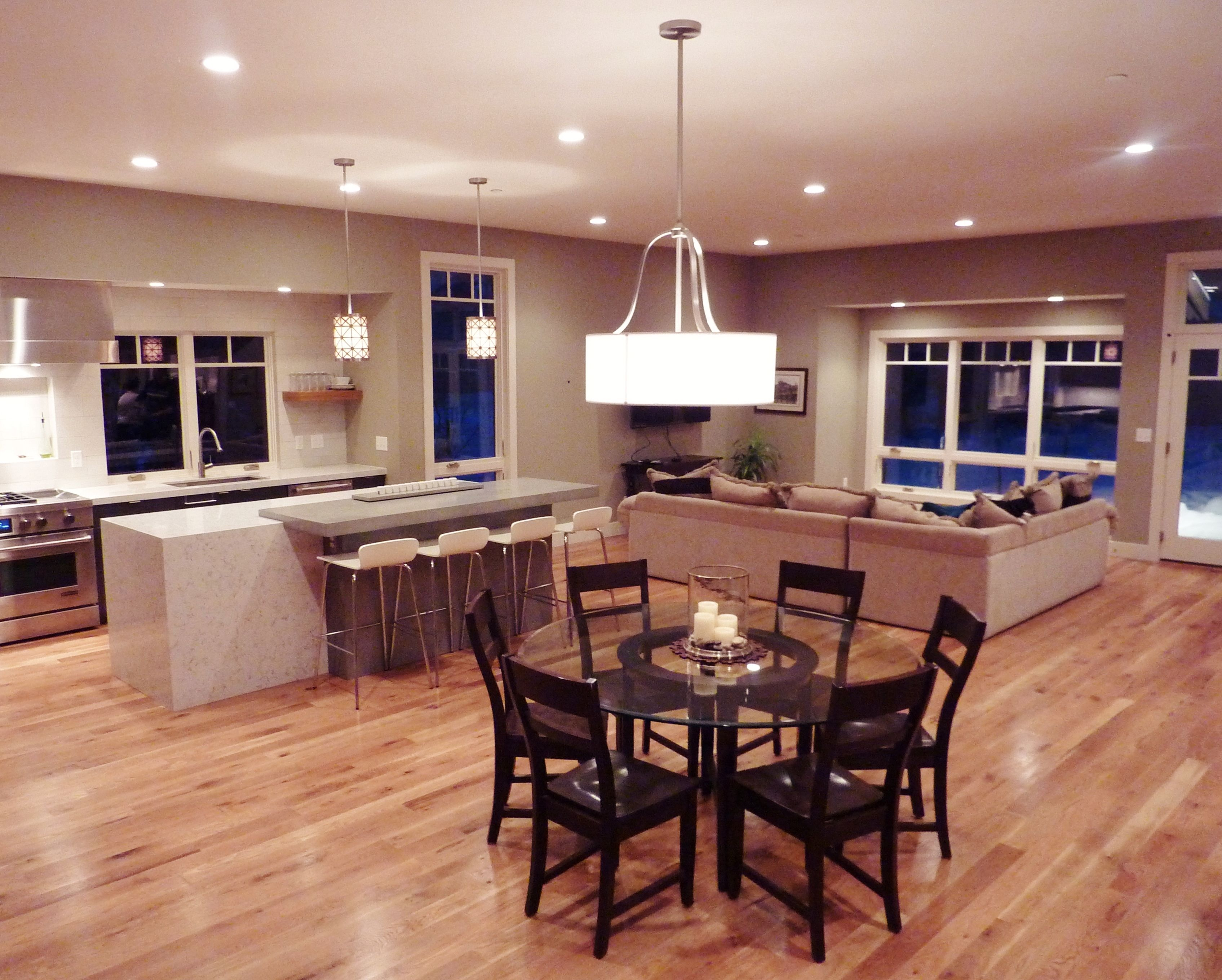 Combined living room, dining room, and kitchen with clean ...