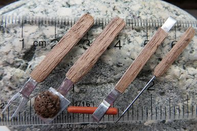 Dollhouse miniature barbecue tool set made from wood veneer and a recycled pie plate.