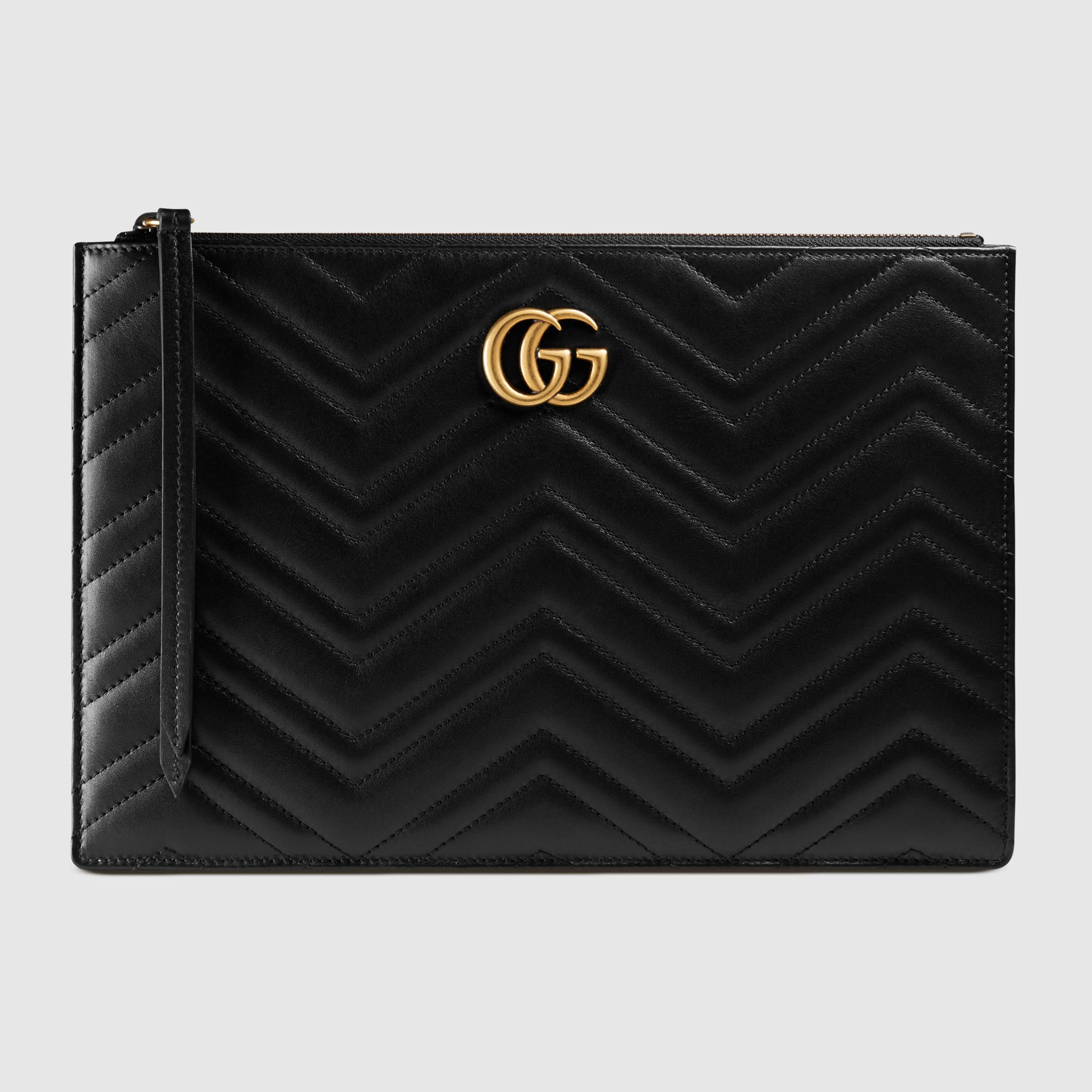 2ef4c5bee4d4dc Shop the GG Marmont matelassé leather pouch by Gucci. The GG Marmont pouch  has a softly structured shape and a top zip closure. The hardware is  inspired by ...