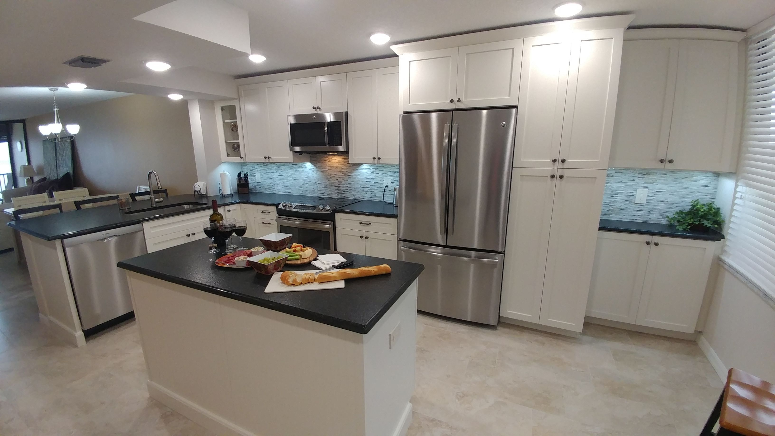 After The Kitchen Is So Open Now Alabaster Shaker Style Cabinets By Eudora With Black Leather Granite Shaker Style Cabinets Leather Granite Shell Backsplash