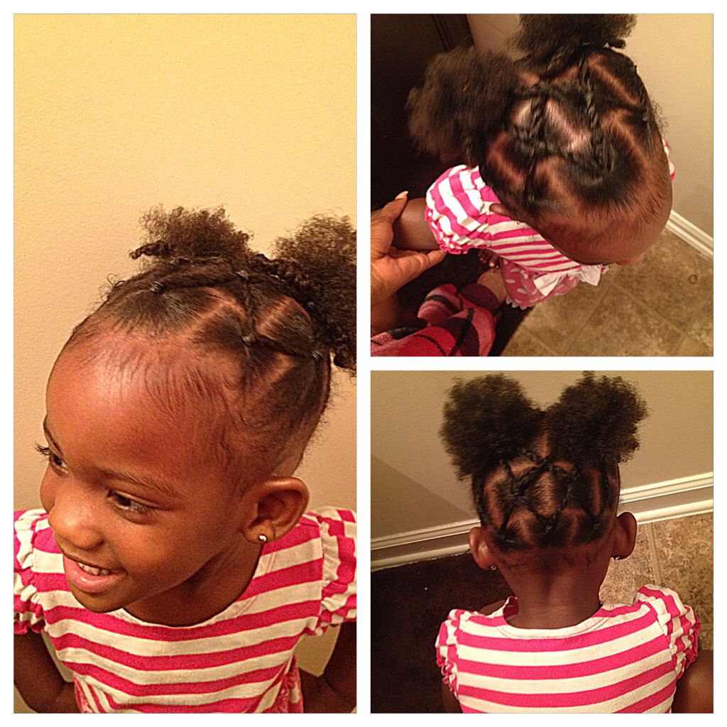 rope twists into two puff balls // natural hairstyles for