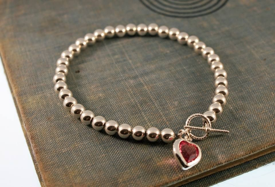 Sterling silver bracelet with Swarovski crystal charm by GFBeads   https://www.facebook.com/permalink.php?story_fbid=235238843302333&id=181324995360385&substory_index=0