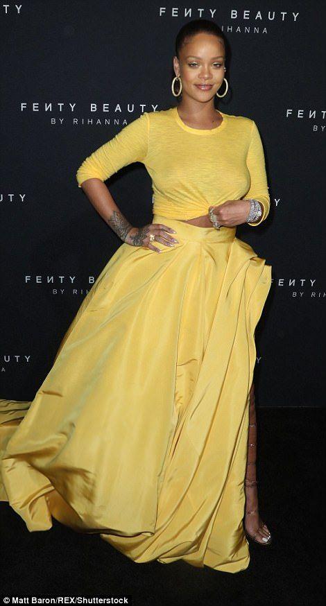 f29b766fd0 Rihanna glows in yellow skirt for Fenty Beauty launch